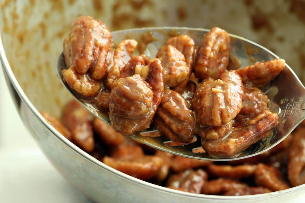 Candied Pecans on Slotted Spoon
