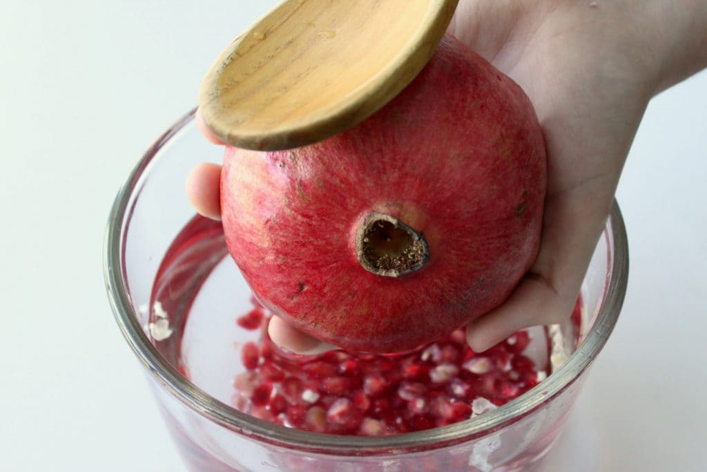 Pomegranate Seed Removal - Tapping Out the Arils with Spoon